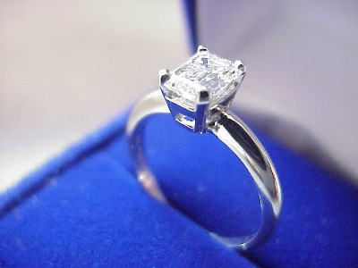 Emerald Cut Diamond Ring: 0.96 carat in Basket Style Mounting