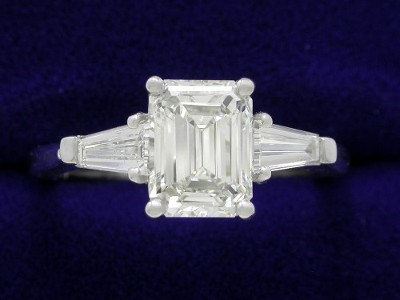 Emerald Cut Diamond Ring: 1.17 carat with 1.32 ratio in 0.30 tcw Tapered Baguette mounting