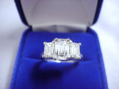 Emerald Cut Diamond Ring: 1.18 carat with 1.50 ratio in 0.99 tcw Emerald Side Diamonds