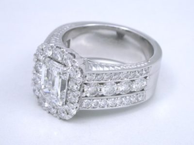 Diamond  ring with 1.20-carat emerald cut diamond prong-set in an 18-karat white-gold custom mounting with 1.42 total carat weight of round brilliant cut diamonds