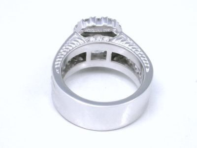 1.20-carat emerald cut diamond prong-set in an 18-karat white-gold custom mounting with hand-carved designs on the side of the shank