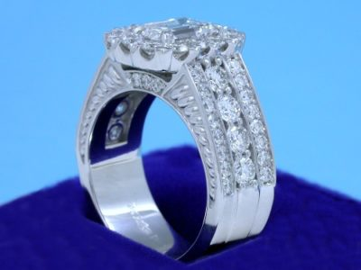 Diamond  ring with 1.20-carat emerald cut diamond prong-set in an 18-karat white-gold mounting with 8 shared-prong set on the shank and 38 pave-set diamonds in flanking rows on the shank and 3 on each side of the shank under the head