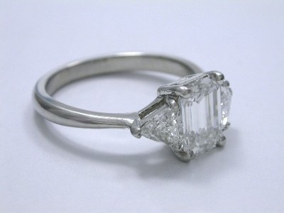 Three Stone Ring with Emerald Cut Diamond and Side Trillion Side Diamonds