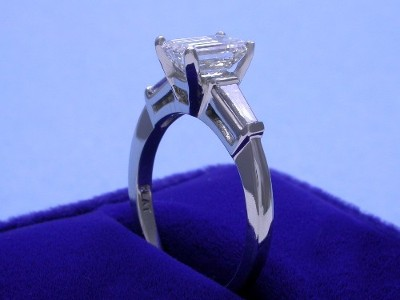 Emerald Cut Diamond Ring: 1.27 carat with 1.50 ratio in 0.32 tcw Tapered Baguette mounting