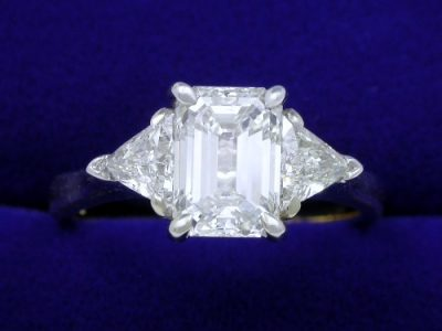 Special Offer: Emerald Cut 1.32 carat H VS1 with 0.46 tcw Trillion Side Diamond Ring