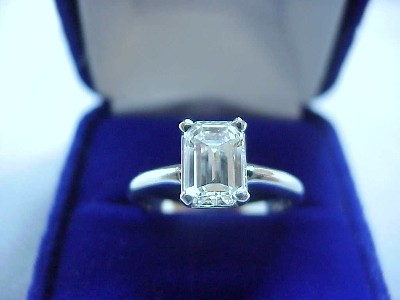 Emerald Cut Diamond Ring: 1.42 carat with 1.45 ratio in Basket Syle Mounting