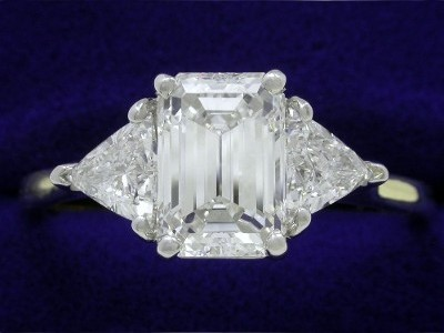 Emerald Cut Diamond Ring: 1.90 carat with 1.44 ratio in 0.70 tcw Trillion mounting