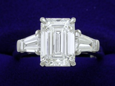 Emerald Cut Diamond Ring: 2.20 carat with 1.43 ratio in 0.64 tcw Tapered Baguette Mounting