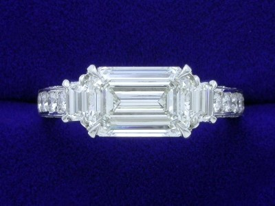 Emerald Cut Diamond Ring: 2.50 carat with 1.44 ratio and 0.34 tcw Trapezoids in 0.56 tcw pave mounting