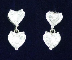 2.74 total carat weight Heart Shaped diamond earrings in 18-karat Shepherd's Hook style wire mountings.