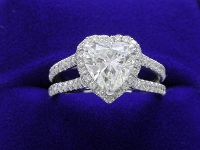 Heart Shaped Diamond Ring: 1.50 carat with 1.01 ratio and 0.95 tcw pave Split Shank mounting