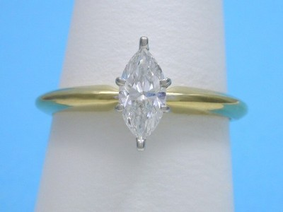 14-karat yellow gold mounting with a 14-karat white-gold six-prong Solitaire style head