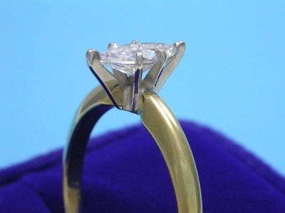 Marquise Cut Diamond Ring: 0.59 carat with 2.00 ratio in six-prong yellow-gold Solitaire style mounting