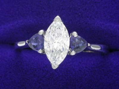Marquise Cut Diamond Ring: 0.79 carat with 0.45 tcw Blue Sapphire Trillions