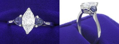 Marquise Cut Diamond Ring: 0.79 carat with 1.90 ratio in 0.45 tcw Blue Sapphire Trillion Three Stone mounting