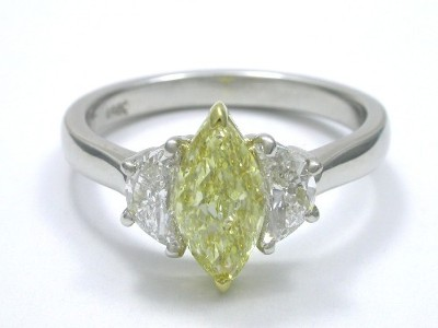 Diamond ring with 0.90 carat marquise modified diamond graded Natural Fancy Yellow color