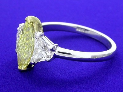 Fancy Yellow Color Marquise Cut Diamond Ring with Crescent Trapezoids
