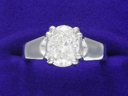 1.51 carat Oval Brilliant diamond ring with H color and SI1 clarity set in a 14-karat white gold Trellis style mounting.