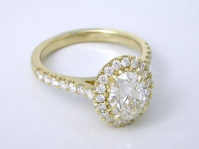 14-karat yellow-gold mounting with U-set round diamonds 1.3 mm on the halo and 1.5 mm going half way down the shank