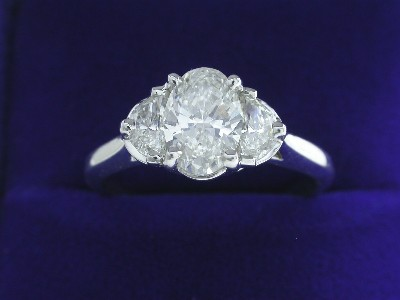 Oval Cut Diamond Ring: 1.00 carat with 0.40 tcw Half Moon diamonds