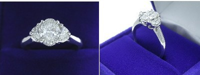 Oval Diamond Ring: 1.00 carat with 1.41 ratio in 0.40 tcw Half Moon Cut diamond three-stone mounting