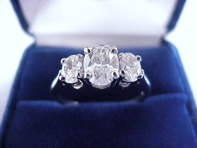 Oval Cut Diamond Ring: 1.01 carat with 0.70 tcw Oval diamonds