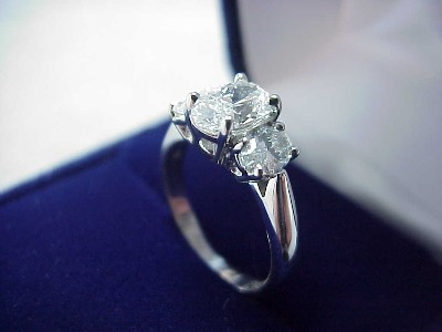 Oval Cut Diamond Ring: 1.03 carat 1.42 ratio with 0.65 tcw Oval diamonds