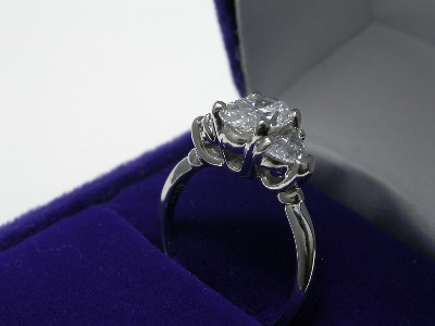 Oval Cut Diamond Ring: 1.08 carat 1.43 ratio with 0.60 tcw Crescent Moon diamonds