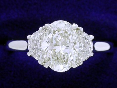 Oval Cut Diamond Ring: 1.08 carat with 1.39 ratio in 0.35 tcw Crescent Moon mounting