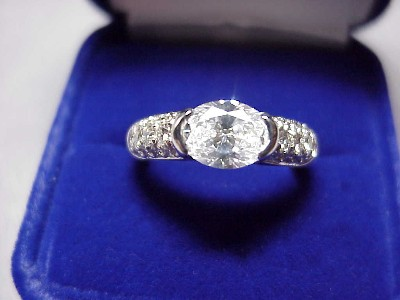 Oval Cut Diamond Ring: 1.17 carat 1.36 ratio in half bezel pave mounting