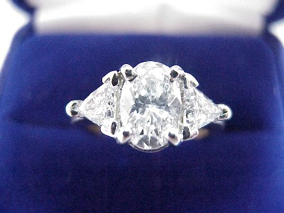 Oval Cut Diamond Ring: 1.20 carat with 0.64 tcw Trillion diamonds