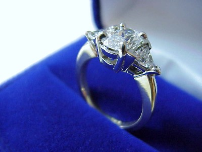 Oval Cut Ring with Trillion Side Diamonds