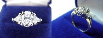 Oval Diamond Ring: 1.20 carat in 0.64 tcw Trillion Cut diamond three-stone mounting
