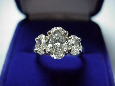 Oval Cut Diamond Ring: 1.20 carat 1.58 ratio with 0.72 tcw Oval diamonds