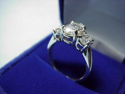 Oval Cut Three-Stone Diamond Engagement Ring
