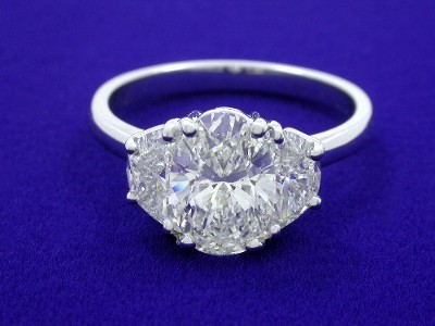 Oval and Crescent Diamond Engagement Ring