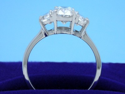 Oval and Crescent Moon Diamond Three-Stone Engagement Ring
