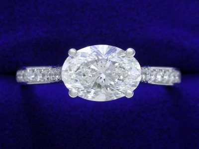 Oval Cut Diamond Ring: 1.24 carat with 1.40 ratio in 0.21 tcw Pave mounting