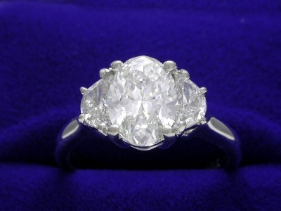 Oval Cut Diamond Ring: 1.32 carat with 1.38 ratio 0.45 tcw Crescent Moon Side Diamonds