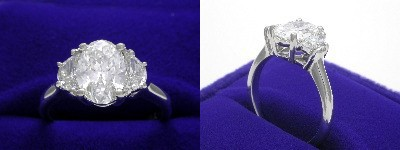 Oval Diamond Ring: 1.32 carat with 1.38 ratio in 0.45 tcw Crescent Moon Cut diamond three-stone mounting