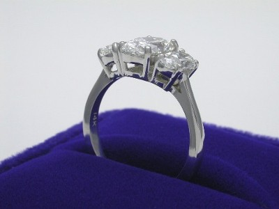 Oval Cut Diamond Ring: 1.33 carat with 1.39 ratio 0.90 tcw Side Oval Diamonds