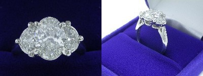 Oval Diamond Ring: 1.50 carat with 1.40 ratio in 0.61 tcw Half Moon Cut diamond three-stone mounting