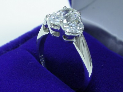 Oval Cut Diamond Ring: 1.51 carat 1.30 ratio with 0.68 tcw Half Moon diamonds