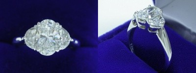 Oval Diamond Ring: 1.51 carat with 1.46 ratio in 0.68 tcw Half Moon Cut diamond three-stone mounting