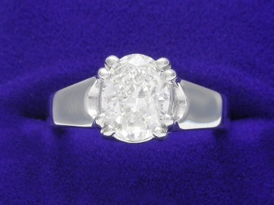 Oval Cut Diamond Ring: 1.51 carat with 1.30 ratio in Trellis style mounting