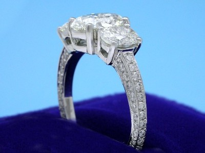 Oval Cut Diamond Ring: 1.51 carat with 1.42 ratio in 1.03 tcw 3-Stone 0.50 tcw pave mounting