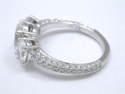 Oval Three Stone Diamond Ring with Oval Side Diamonds and Pave Mounting