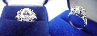 Oval Diamond Ring: 1.52 carat with 1.41 ratio in 0.57 tcw Half Moon Cut diamond three-stone mounting