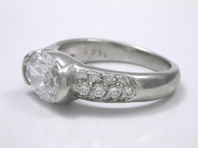 Oval Cut Diamond in Half-Bezel Pave Mounting