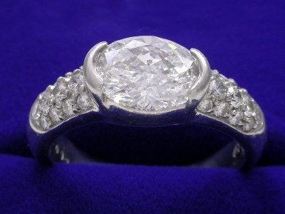 Oval Cut Diamond Ring: 1.54 carat with 1.35 ratio and 0.50 tcw pave mounting